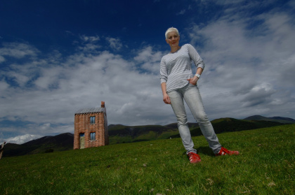 Maddi Nicholson as a giant woman, with her terrace on tour, inflated house, Cumbria 2009.
